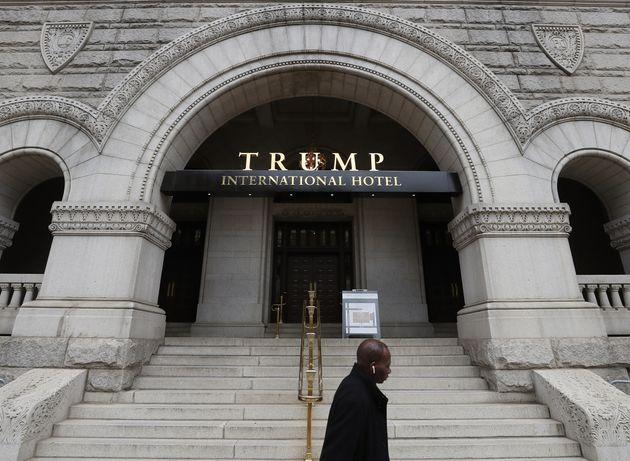 WASHINGTON, DC - OCTOBER 25: People walk past the Trump International Hotel on Pennsylvania Ave. on October...