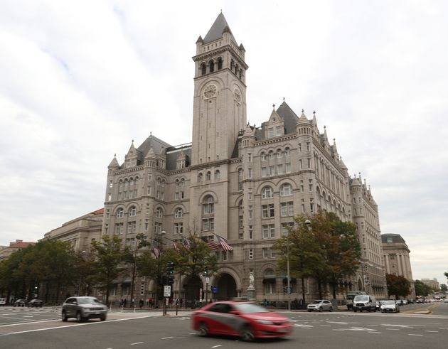 WASHINGTON, DC - OCTOBER 25: Traffic passes by the Trump International Hotel on Pennsylvania Ave. on...