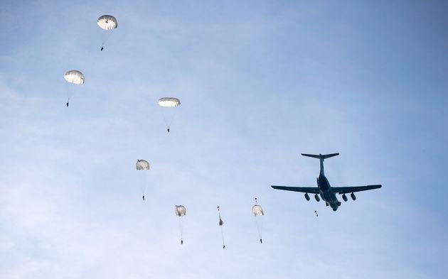 BREST REGION, BELARUS - OCTOBER 22, 2019: Servicemen descending with parachutes from an Ilyushin Il-76...