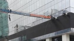 Shocking Video Shows Edmonton Window-Washer Dangling Off Swinging