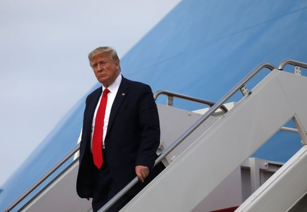 U.S. President Donald Trump exits Air Force One after returning from South Carolina to Joint Base Andrews...