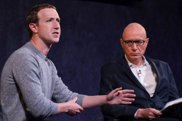 NEW YORK, NY - OCTOBER 25: Facebook CEO Mark Zuckerberg and News Corp CEO Robert Thompson speak about...