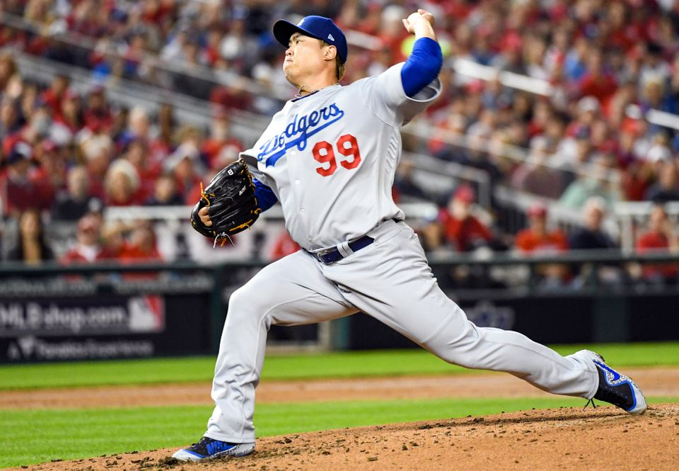 WASHINGTON, DC - OCTOBER 06: Los Angeles Dodgers starting pitcher Hyun-Jin Ryu (99) pitches in the second...