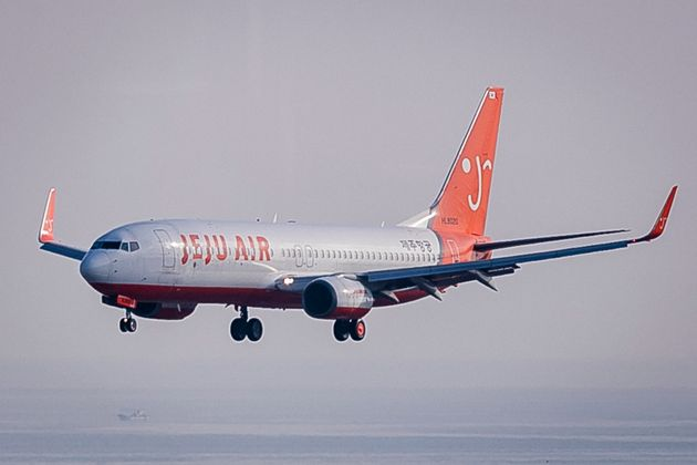 JEJU, SOUTH KOREA - APRIL 18: A Jeju Air Boeing 737-86N prepares to land at Jeju International Airport...