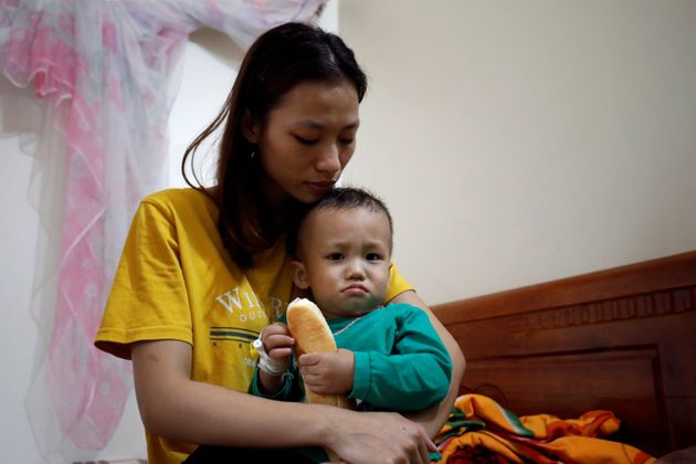 Hoang Thi Thuong, wife of Nguyen Dinh Tu, a Vietnamese suspected victim in a truck container in UK, holds...