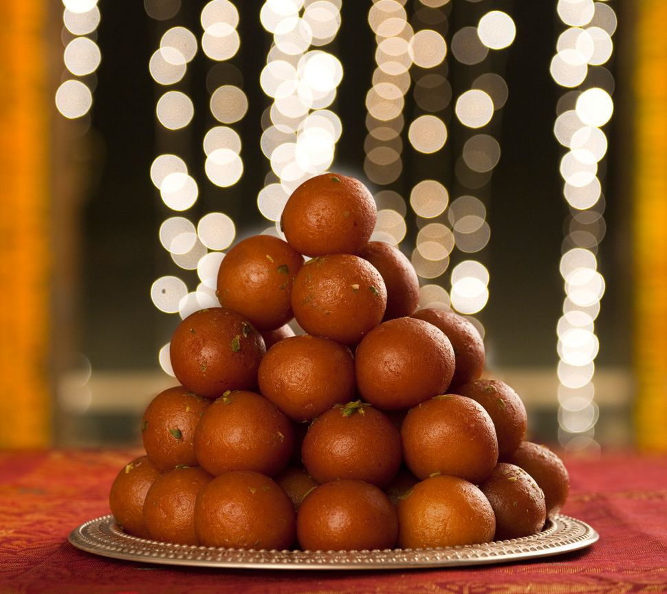 Close-up of a heap of gulab jamuns (a popular traditional Indian sweet)