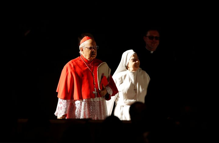 A cardinal and a nun arrive to attend a mass to close a three-week synod of Amazonian bishops at the Vatican, October 27, 201