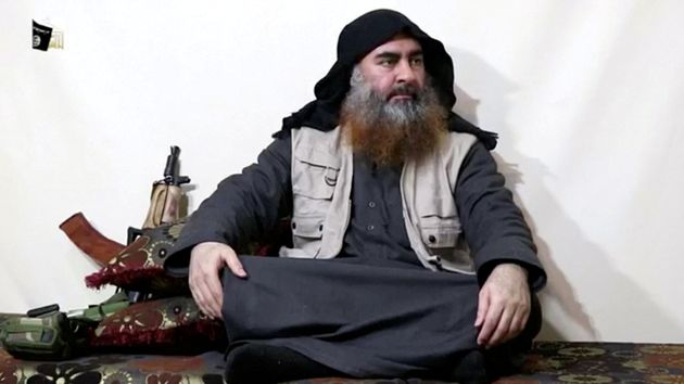 A bearded man with Islamic State leader Abu Bakr al-Baghdadi's appearance speaks in this screen grab...