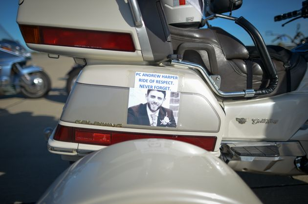 A picture of PC Andrew Harper stuck to a Honda Goldwing