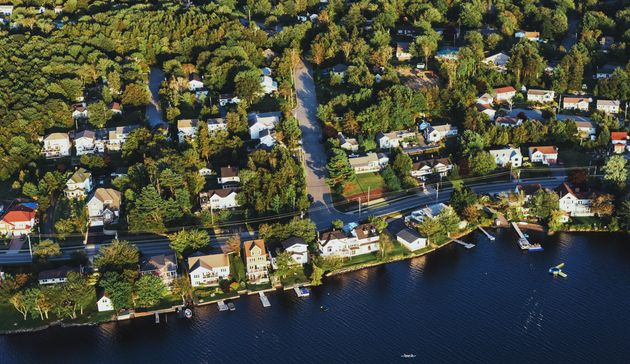 An aerial view of homes lining the shoreline of Lake Micmac in Dartmouth,