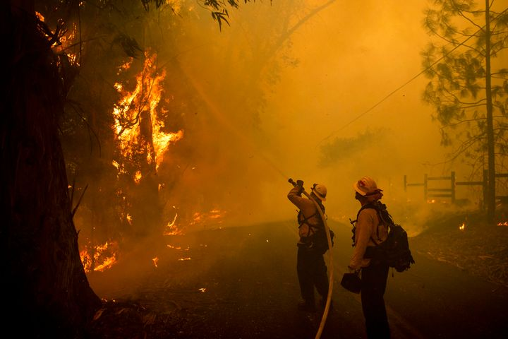 Firefighters battle a wildfire called the Kincade Fire on Chalk Hill Road in Healdsburg, Calif., Sunday, Oct. 27, 2019. (AP P