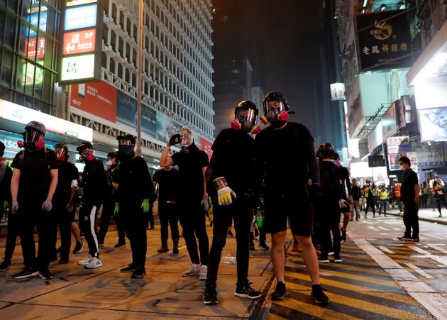 Protesters confront with police (not in the picture) during an anti-government protest in Hong Kong,...