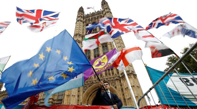 An anti-Brexit protester waves an EU flag outside the Houses ofParliamentin London, Britain, October...