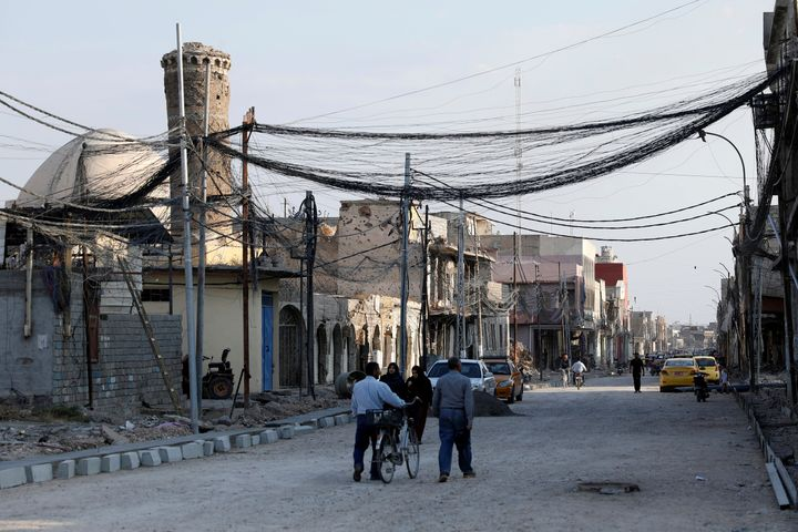 People walk on the street, where Islamic State leader Abu Bakr al-Baghdadi declared his caliphate back in 2014, in the old ci