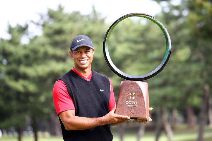 Tiger Woods poses with the winning trophy after capturing the Zozo Championship in Japan on Monday.
