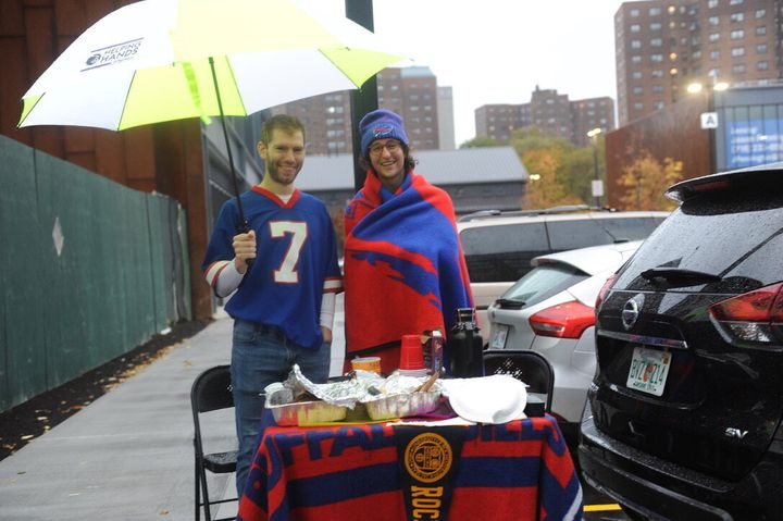 "Brad Orego (L) and Jeff Pollock hunkered down for a tailgate in the Wegmans parking lot. ""We're planning to watch the Bills/Eagles game at the bar upstairs,"" Orego told HuffPost."