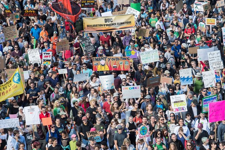 Demonstrators march during a climate strike in Montreal, Sept. 27, 2019.