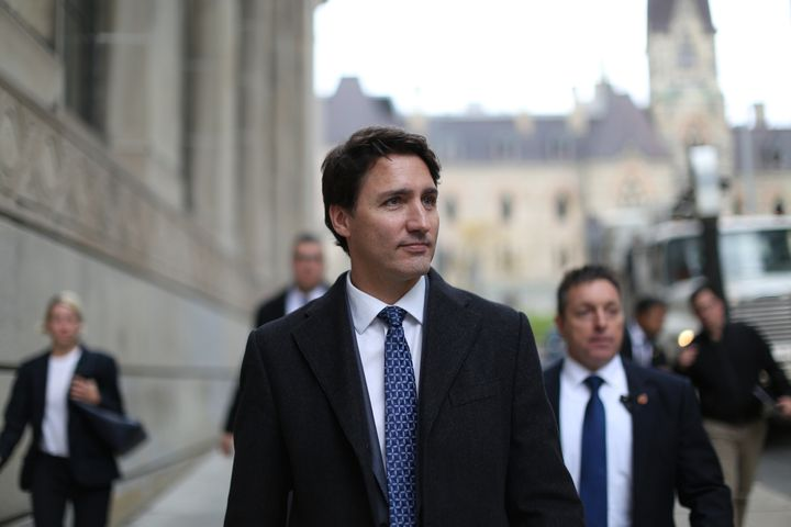 Prime Minister Justin Trudeau walks back to his office, Oct. 23, 2019 in Ottawa, after reiterating his support for the Trans Mountain expansion project at a news conference.
