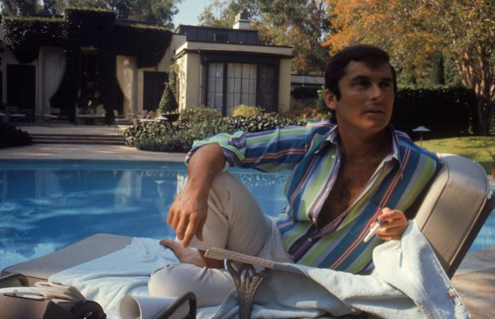 Then VP of Paramount Pictures Robert Evans studying his script by the pool at his home. (Photo by Alfred Eisenstaedt/The LIFE