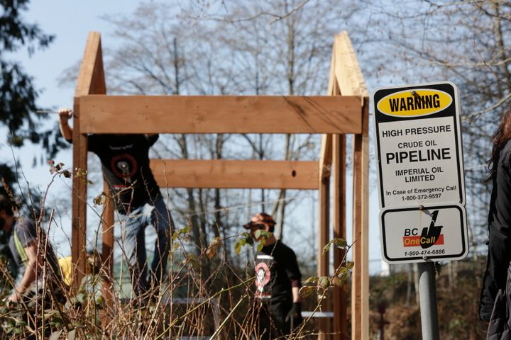 A traditional Coast Salish Watch House under construction, adjacent to Kinder Morgan's Trans Mountain pipeline, built in protest to the pipeline expansion in Burnaby, B.C., March 10, 2018.