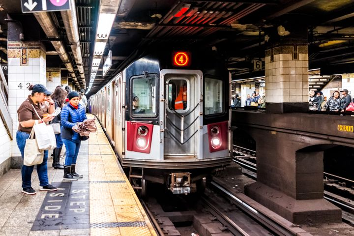 A New York City man was filmed being arrested on a subway train (a similar one pictured) by multiple officers on Friday after