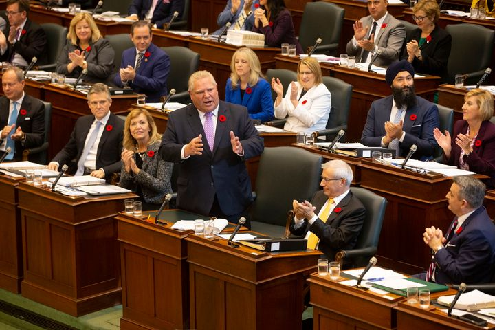 Ontario Premier Doug Ford receives applause from seated PC MPPs as he speaks in the Ontario legislature in Toronto, on Oct. 28, 2019.