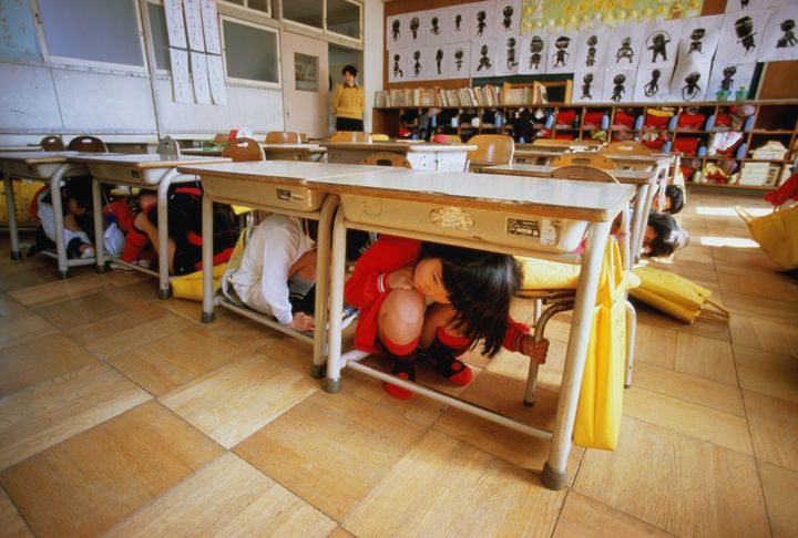 In this image, children in Japan experience in an earthquake drill at school. Today, students in countries all around the wor