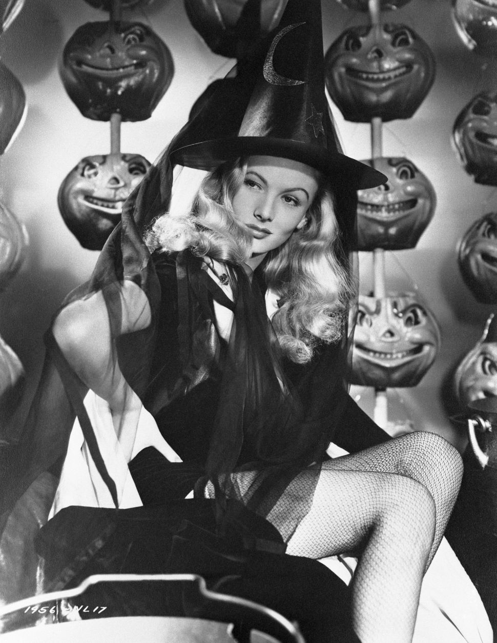 "Veronica Lake, who coincidentally starred in a 1942 movie called ""I Married A Witch,"" poses for a Halloween photo for Paramount Studios."