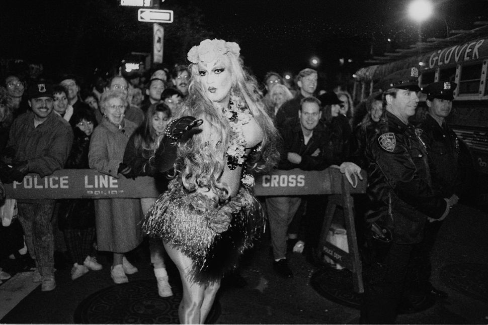 A drag queen marches in the Greenwich Village Halloween Parade, sometime in the 1970s.