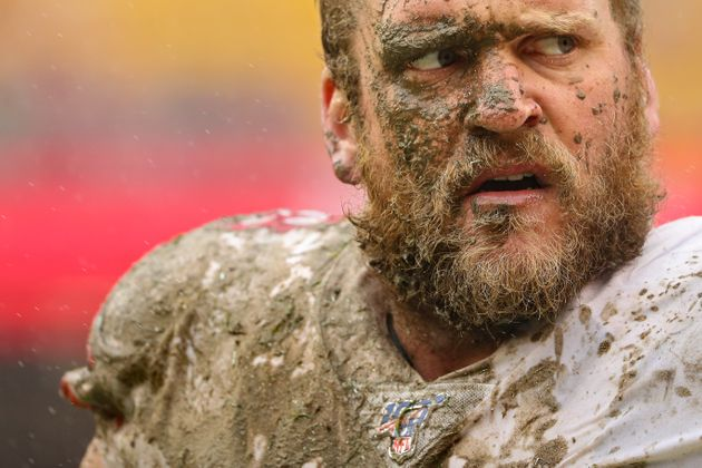 LANDOVER, MARYLAND - OCTOBER 20: Covered in mud, offensive guard Mike Person #68 of the San Francisco...