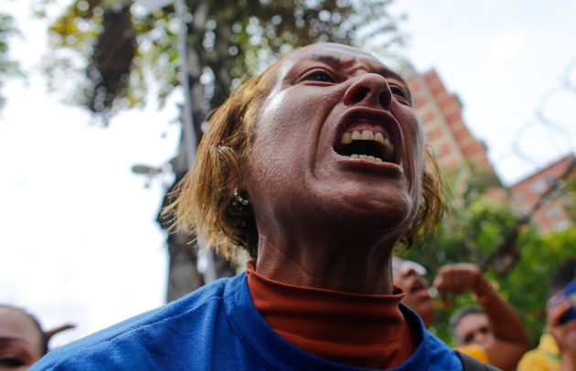An opposition protester yells at soldiers of the National Guard blocking the way to the headquarters...