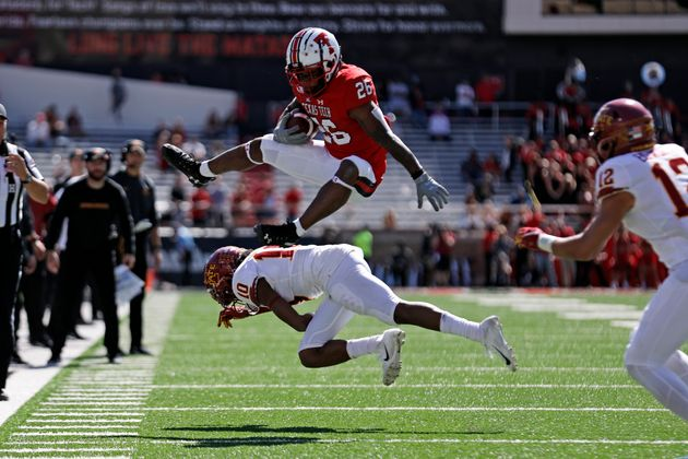Texas Tech's Ta'Zhawn Henry (26) hurdles over Iowa State's Tayvonn Kyle (10) during the second half of...