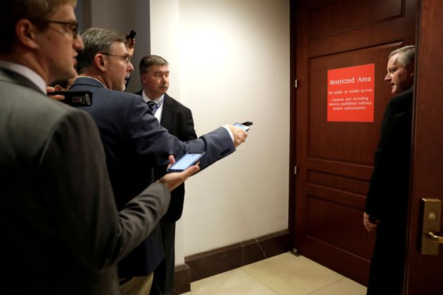Congressman Mark Meadows (R-NC) looks back at reporters as he enters a secure area as Deputy Assistant...