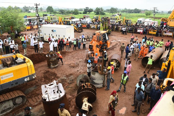 Rescue workers gather with heavy digging equipment during the operation to rescue Sujith Wilson near Manapparai town in Tiruchirappalli district, on October 28, 2019.