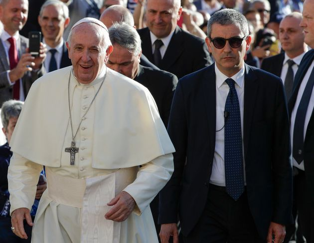 Pope Francis, flanked by newly appointed Vatican head of security Gianluca Gauzzi Broccoletti, arrives...