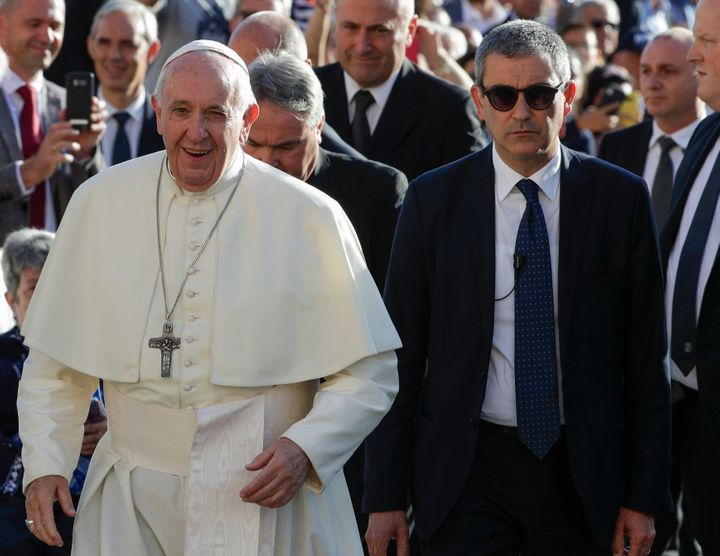 Pope Francis, flanked by newly appointed Vatican head of security Gianluca Gauzzi Broccoletti, arrives for his weekly general audience, in St.Peter's Square, at the Vatican, Wednesday, Oct. 16, 2019. (AP Photo/Andrew Medichini)