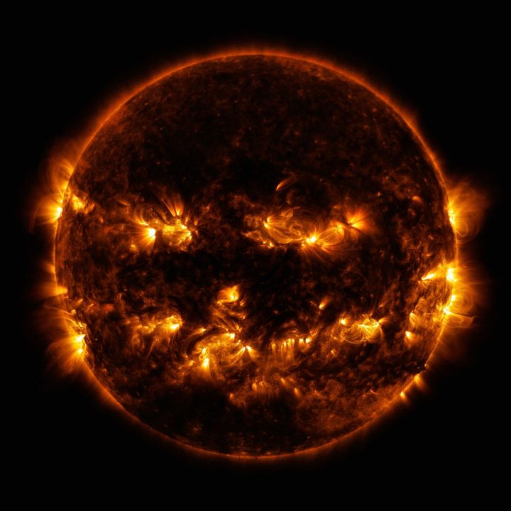 In this Oct. 8, 2014 photo released by NASA, active regions on the sun combine to look something like a jack-o-lantern's face