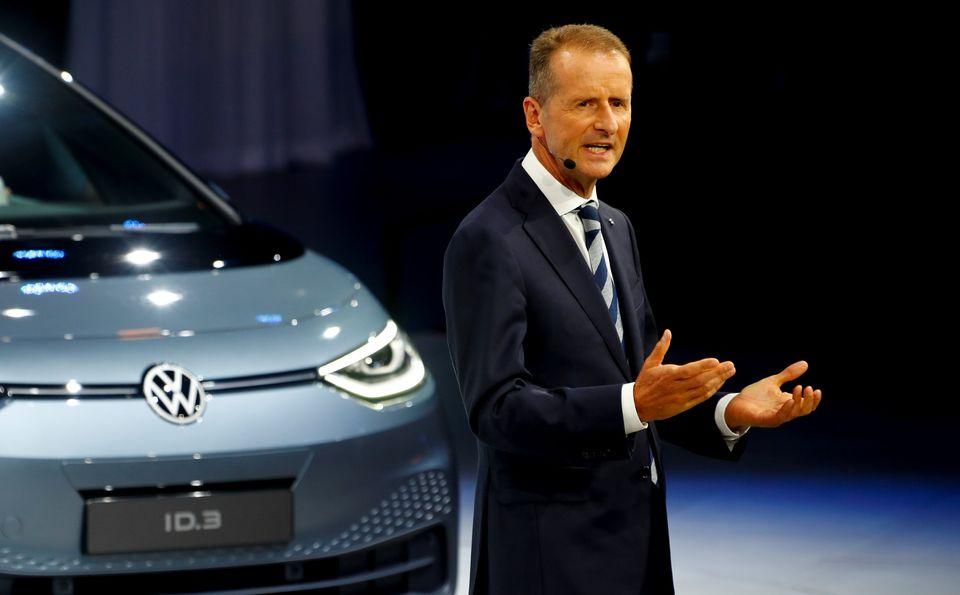 Herbert Diess, CEO of German carmaker Volkswagen AG, gestures in front of an ID.3 pre-production prototype...