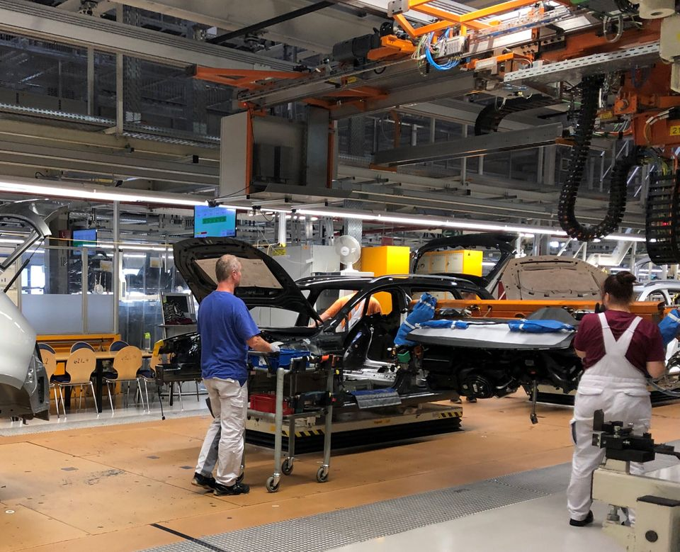 Workers install dashboards in Volkswagen ID.3 cars at the automaker's Zwickau assembly plant in Zwickau,...