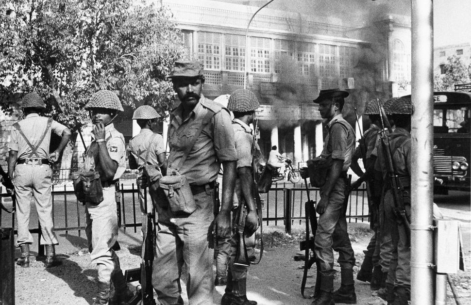 Indian army soldiers take up their positions in New Delhi, 1 November, 1984, a day after Prime Minister Indira Gandhi was shot.