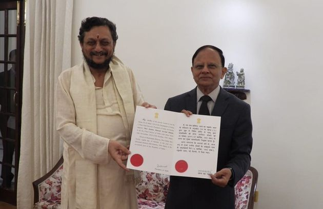 Principal Secretary to PM, PK Mishra, presents the warrant of appointment to Chief Justice of India designate,...
