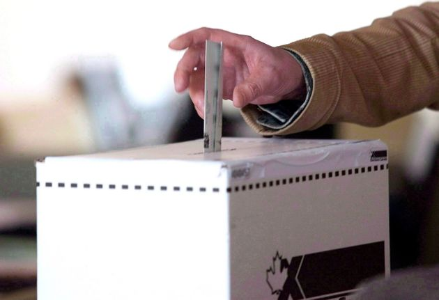 A voter casts a ballot in the 2011 federal election in Toronto on May 2, 2011. A new poll suggests 10...