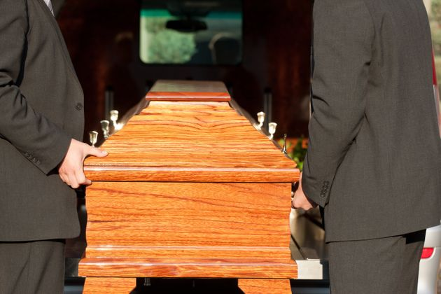 Dolor - Funeral with coffin on a cemetery, the casket carried by coffin