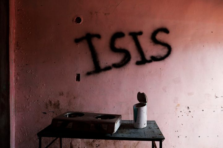 "Pro-Islamic State groups operate outside of Syria and Iraq. Here, the word ""ISIS"" is seen spray-painted in a home in Marawi C"