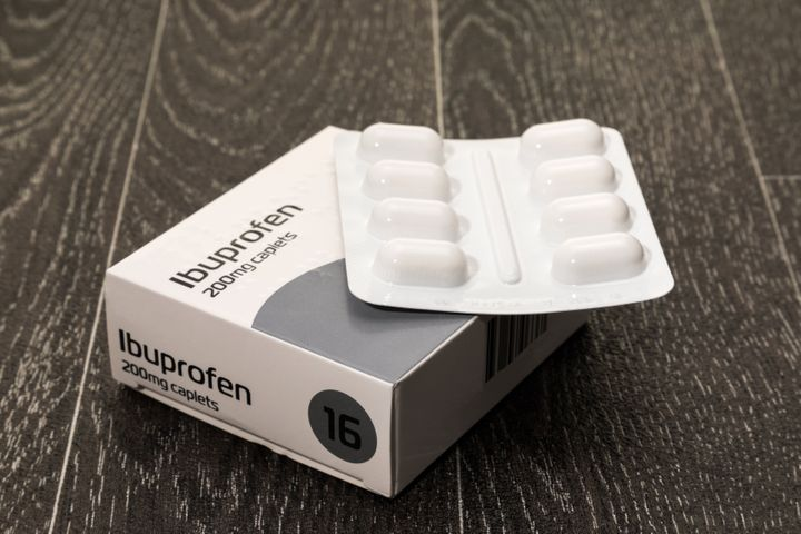 Retail packet of Ibuprofen tablets - white background