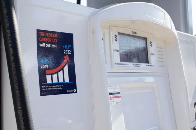 A gas pump displays an anti-carbon tax sticker in Toronto on Aug. 29, 2019.