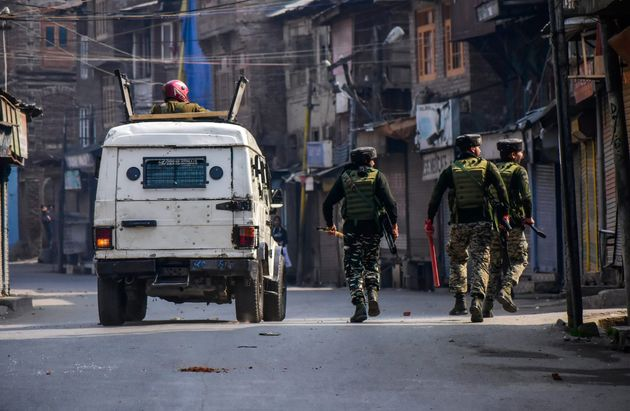 Paramilitary troopers patrol a street during clashes on October 29,