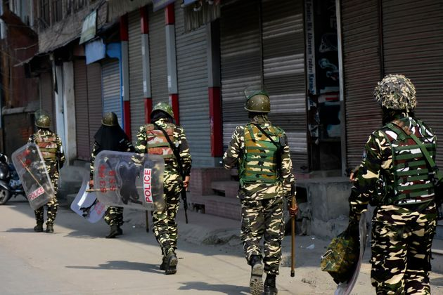 Indian forces patrol the streets in old city,