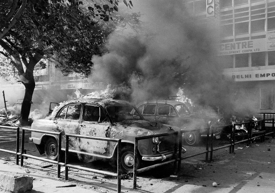 A fleet of Sikh owned cars burn and are covered in thick black smoke after they were set on fire in New...