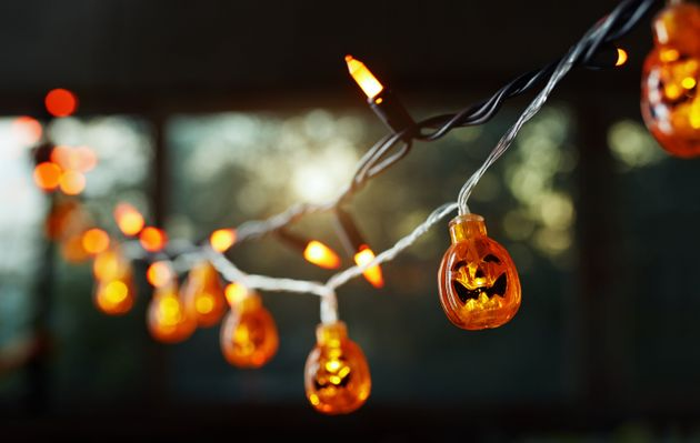 Pumpkin electric light string against the window. Halloween